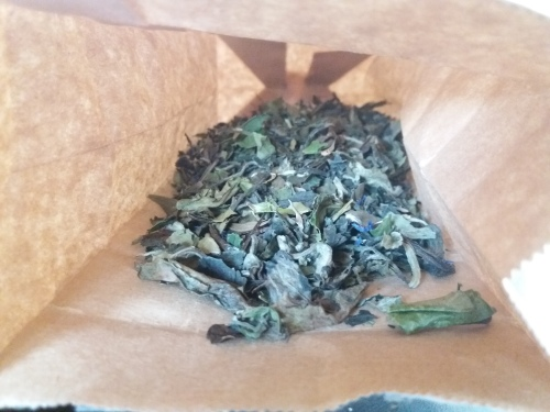 A special loose leaf tea blend in a brown paper bag