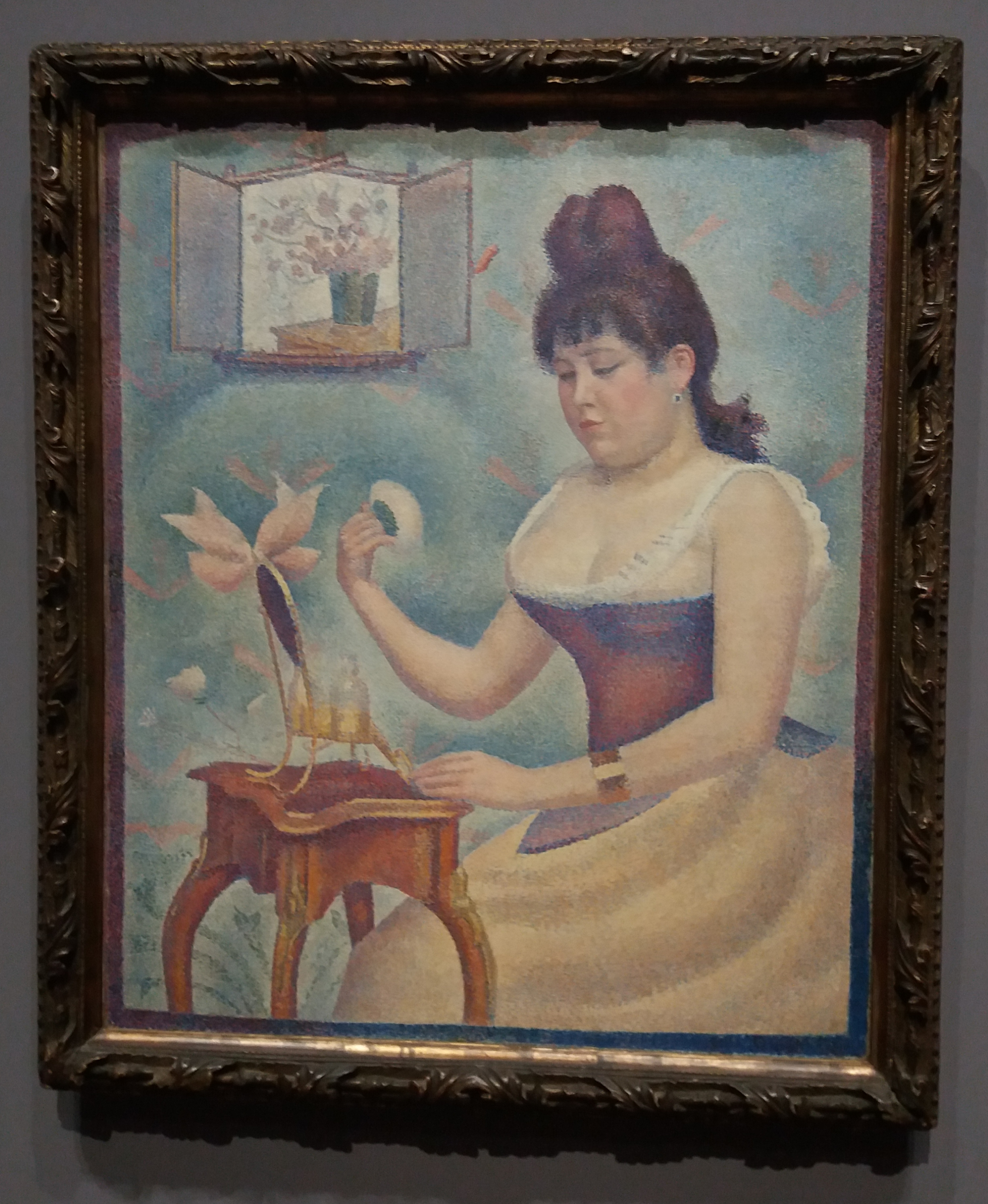 'Woman Powdering Herself', a painting in the pointillist style by Georges Seurat